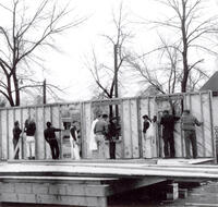 Setting exterior wall for student project house, 1955-1956