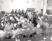 Students and faculty in the cafeteria of the 400 South 600 East campus, circa late 1950s