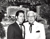 Colonel Harlan Sanders poses with a former student, early 1960s