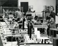 Factory Workers Working at their Desks