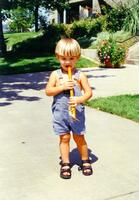 A Child Playing a Wooden Flute