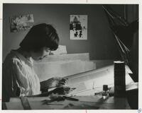 A Student Working in the Graphic Design Program