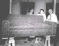 Fritz A. Barthel, Dhorus T. Davis, and James Tanimine with a newly upholstered couch, 1952
