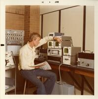 A Student in the Electronics Program Working with Equipment