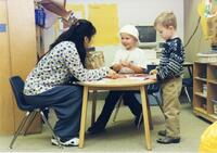 Student Playing with Children in the Eccles Early Childhood Development Lab School