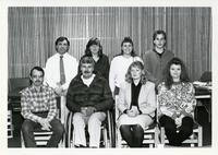 Eight College Employees Seated for a Group Photograph