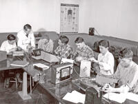 DeRay Parker and students in electronics lab using electronic equipment, circa 1951-1953