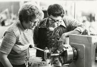Student And Teacher Observe Machinery