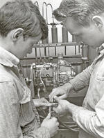 Students working on a machine, circa 1956-1957