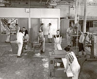 Students using machines in machine shop, circa 1956-1957