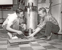 Students repairing water heater, circa 1950s