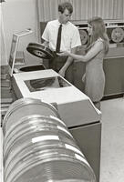 Students replacing data processing drive, circa early 1960s
